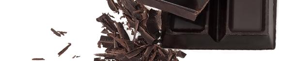 Dark chocolate and trimmings (closeup)