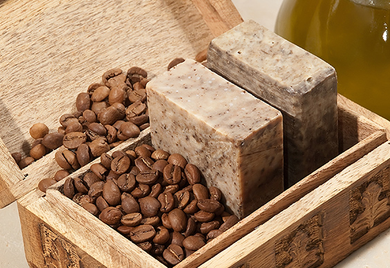 Coffee beans and soap bars in a carved wooden box.